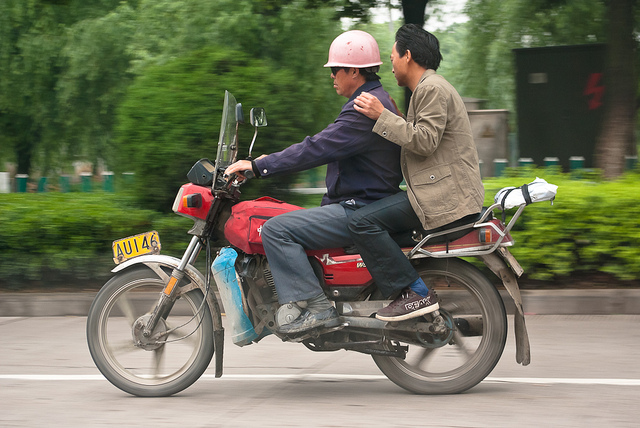 Car pooling with a motorcyle is not recommended though. By Robert S. Donovan, CC BY 2.0